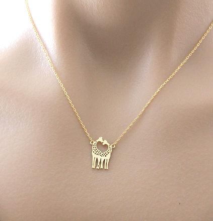collier giraffe doré