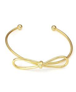 Bracelet noeud or. Manchette noeud dore