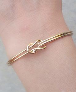 bracelet double noeud or.Idees cadeaux bijoux femme. Bijoux tendance 2017. Bracelet tendance 2017