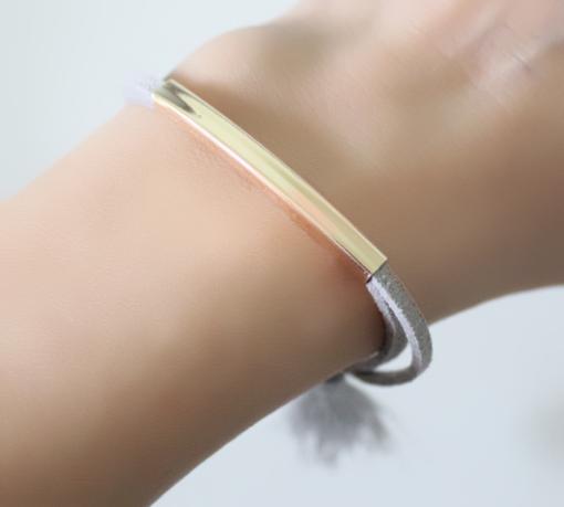 Bracelet suède pompon gris