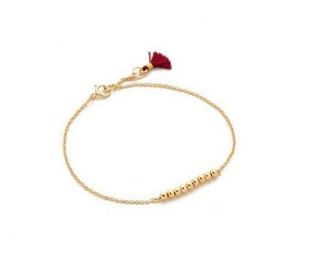 Bracelet porte bonheur doré mat